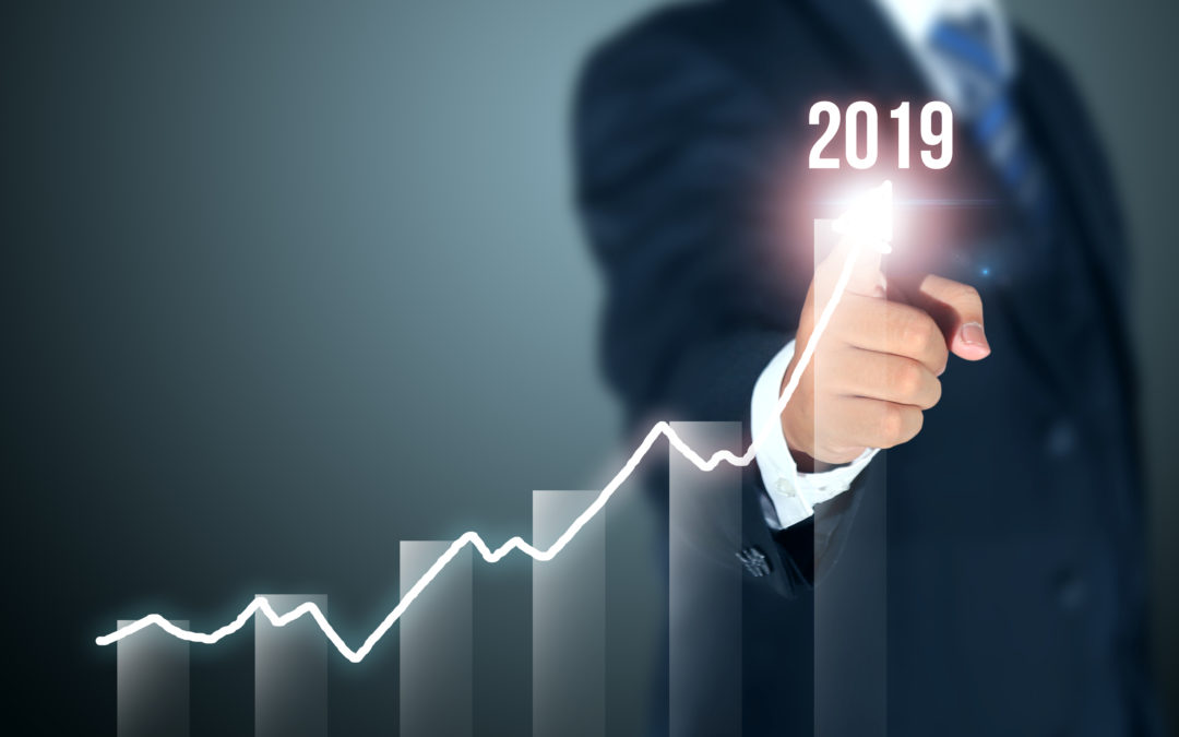 business man's finger traces graph upwards to 2019 equipment finance outlook report